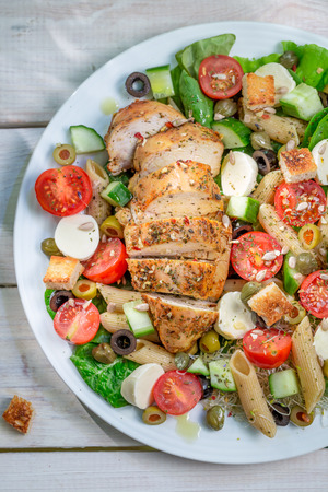 lite food: Caesar salad with fresh vegetables and chicken