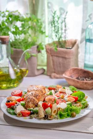 lite food: Caesar salad with fresh spring vegetables Stock Photo