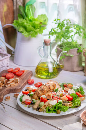 lite food: Spring salad in the sunny kitchen Stock Photo