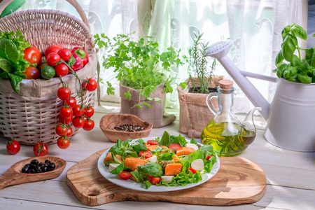 Ingredients for salad with salmon and vegetables photo
