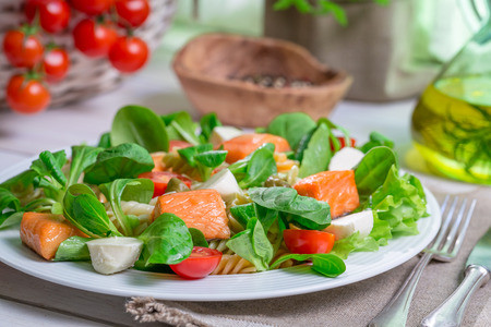Closeup of homemade salad with salmon and vegetables photo