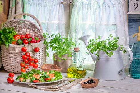 Spring kitchen full of fresh vegetables photo