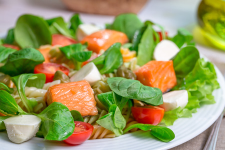 lite food: Closeup of salmon with vegetables and lettuce