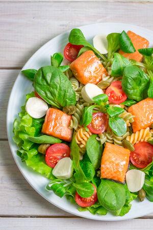 Salad with salmon, spinach and mozzarella photo