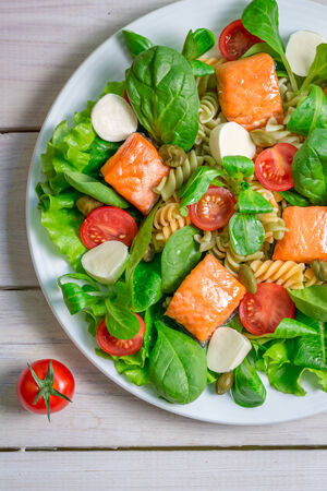 Salad with salmon and fresh vegetables photo