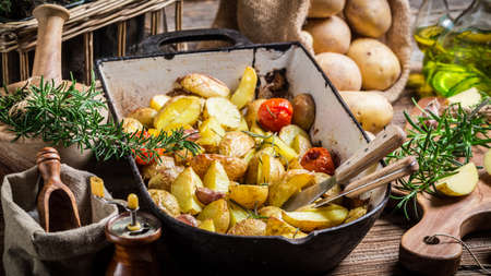 Baked potatoes with rosemary and garlic photo