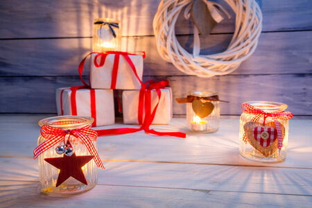 Glowing candles and gifts for Christmas photo