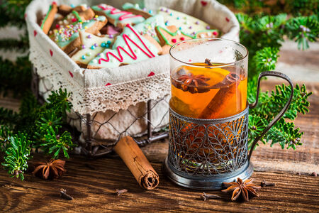 christmas drink: Warming aromatic tea in Christmas evening Stock Photo