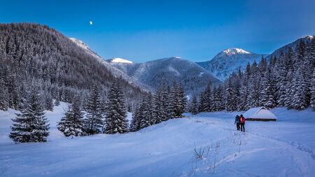 Winter expedition in the mountains at sunset photo