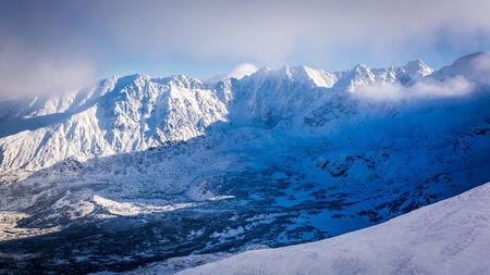snow covered mountain: Snow covered mountain valley at sunrise