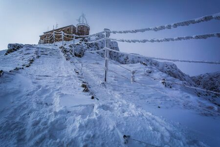 Weather station in the mountains in winter photo