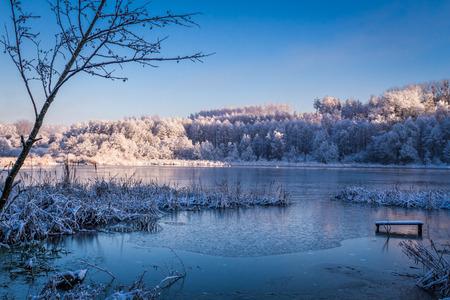 winter sunrise: Winter lake at sunrise