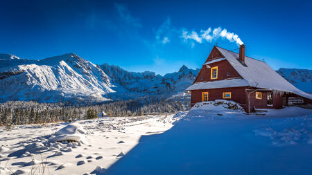 tatra: Warm cottage in winter mountain day