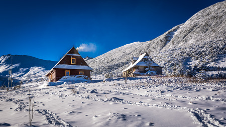 giewont: Wooden houses in winter mountains