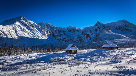 Winter cottages in the high mountains photo
