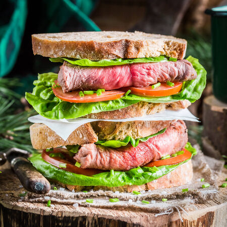 Tasty homemade sandwich with ham and vegetables photo