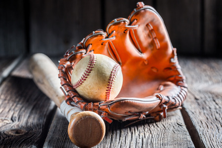 Vintage Baseball in a leather glove photo