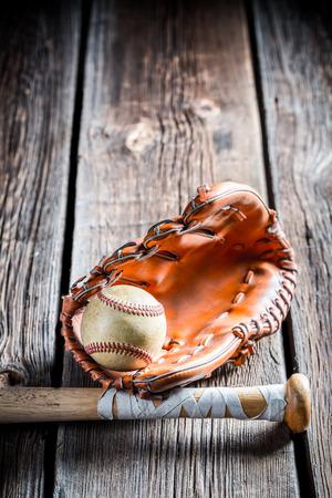 Vintage baseball ball and glove photo