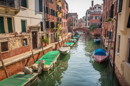 motorboats: Boats and motorboats on a canal in Venice