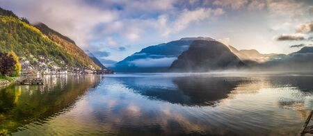 Big panorama of misty lake at dawn in Hallstatt, Austria photo