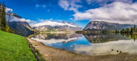 Big panorama of mountain lake between mountains photo