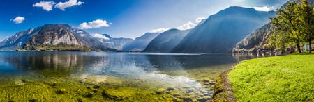 Big panorama of crystal clear mountain lake in Alps photo