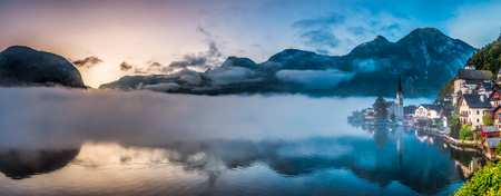 Big panorama of foggy Hallstatt in autumn at dawn photo