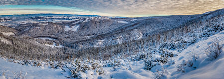 Big panorama of dawn over the mountain valley in winter photo