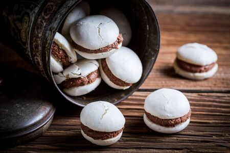 Homemade macaroons with chocolate filling photo