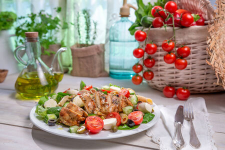 lite food: Salad with chicken cooked in a sunny kitchen