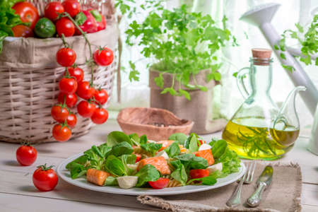 Salmon with vegetables and lettuce photo