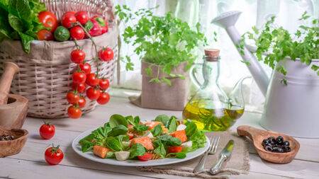 lite food: Fresh vegetables and salmon as ingredients for salad Stock Photo