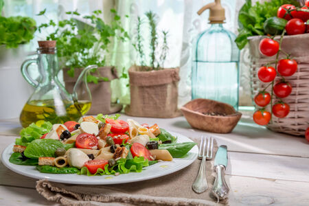 lite food: Spring salad in a sunny kitchen full of vegetables