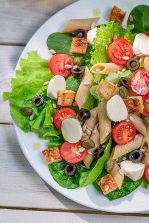 lite food: Healthy salad with vegetables, pasta and croutons