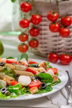 lite food: Spring salad with pasta Stock Photo