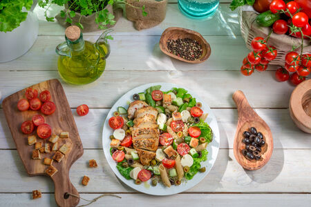 lite food: Caesar salad prepared in spring time Stock Photo