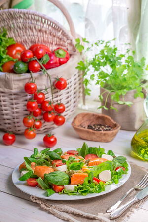 lite food: Ingredients for salad with salmon and vegetables