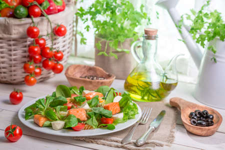 lite food: Healthy salad with fresh vegetables and salmon Stock Photo