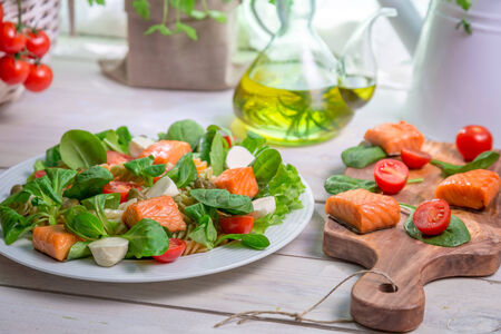 lite food: Salad with salmon, spinach and mozzarella Stock Photo