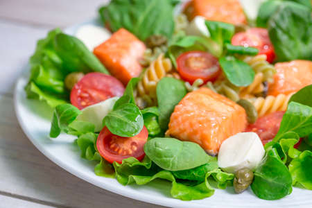 emaciated: Salad with fresh vegetables and salmon