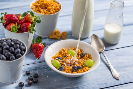 preservatives: Cornflakes with fruits flooded with milk Stock Photo