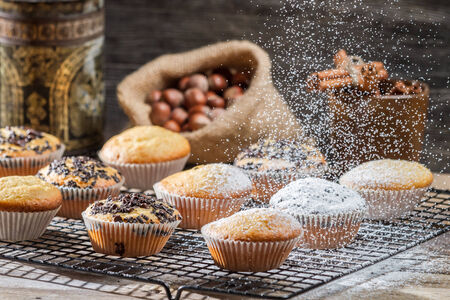 chocolate sweet: Falling powder sugar on vanilla muffins