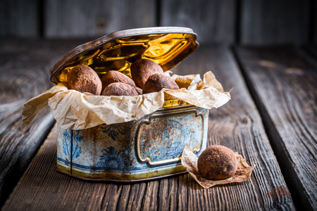 chocolate balls: Chocolate balls in golden box Stock Photo
