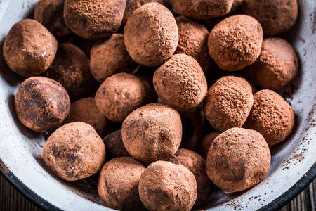 chocolate balls: Closeup of chocolate balls in a white bowl Stock Photo