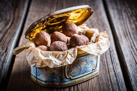 chocolate balls: Homemade chocolate balls in blue box Stock Photo