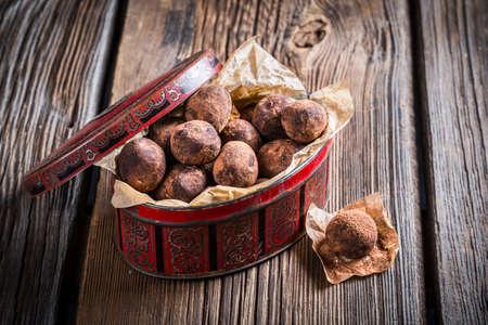 chocolate balls: Sweet chocolate balls in red box Stock Photo