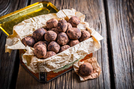 chocolate balls: Small pile of chocolate balls in the box