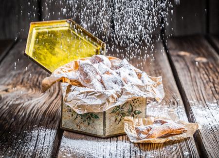 Falling powdered sugar on angel wings in box