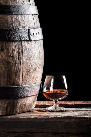 oak barrel: Glass of cognac and old oak barrel