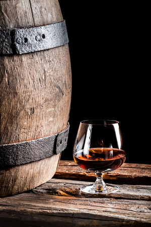 Glass of cognac in the old cellar